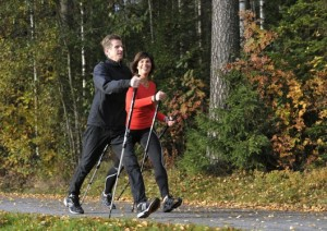 A Swedish person using BungyPump walking poles.
